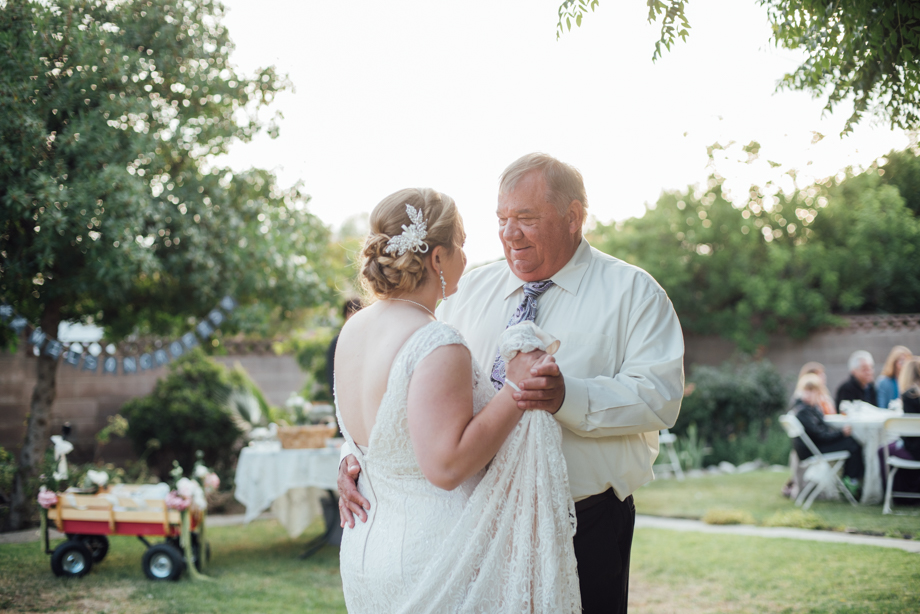 Father daughter dance in backyard rustic wedding
